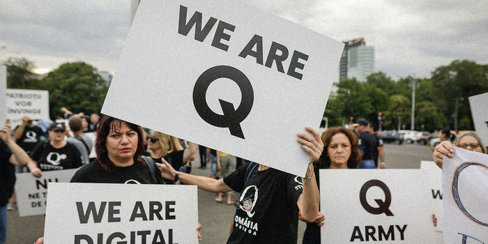 Q Anon supporters with signs.