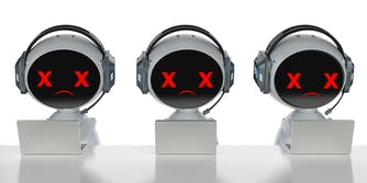 robots with microphone headsets at laptops with X's for eyes and frowns. It is meant to represent robocalls.