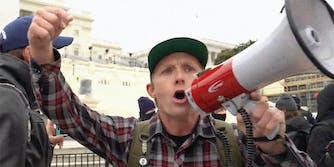Sean McHugh screaming into a megaphone.