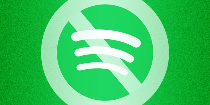 """Spotify logo with """"no"""" symbol about blocking"""