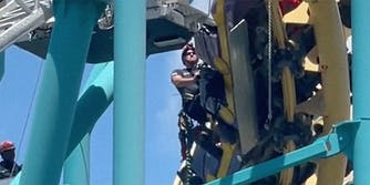A man working on a roller coaster.