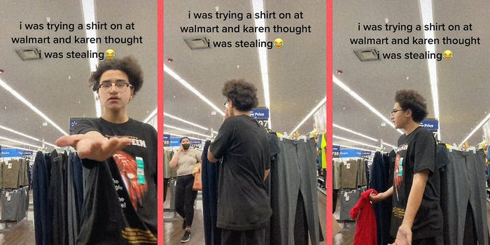 A kid trying on a shirt.