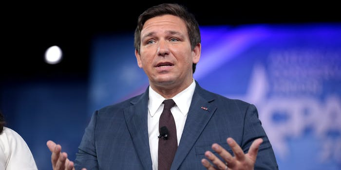 Florida Governor Ron DeSantis holding out his arms in a confused sort of way.