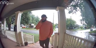 """Ring doorbell camera screenshot of man walking up to porch of father in law's house as he calls him a """"dickhead"""""""