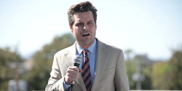 Rep. Matt Gaetz speaking into a microphone while give a speech outside.