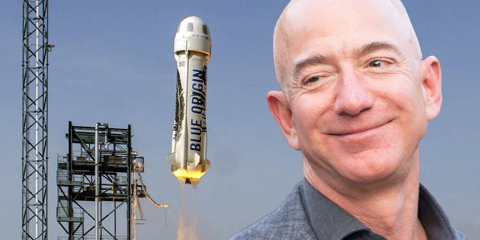 Jeff Bezos smiling and looking at Blue Origin spacecraft