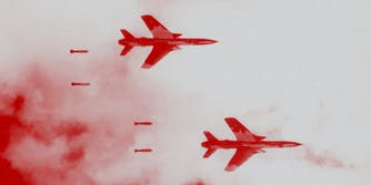 Two fighter planes flying.