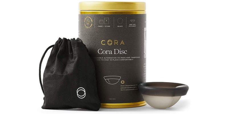 cora menstrual disc with packaging and silk case.