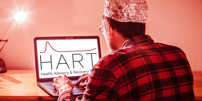 man with aluminum cap with HART Health Advisory & Recovery Team logo on laptop
