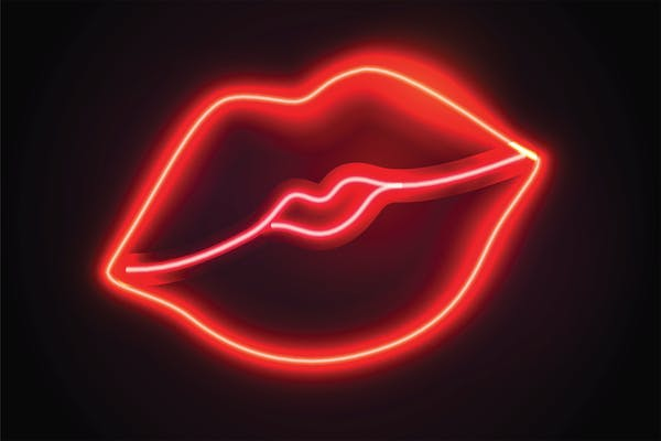 Neon lips like you might find on one of the best virtual sex sites on this list