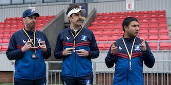 three professional soccer coaches