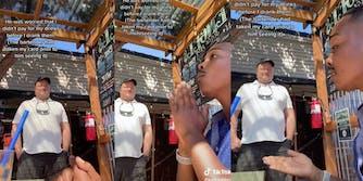 white man standing while black man speaks to him at bar