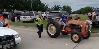 Woman on tractor attempts to evade police