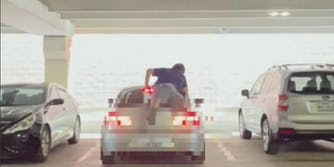 TikToker Dre uploaded a video showing the man climbing the back of a car