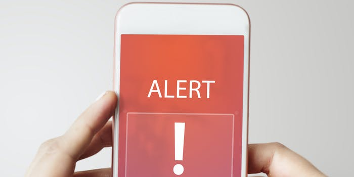 A phone showing an Emergency Alert.