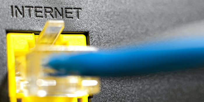 An ethernet cord delivering broadband internet to a router.