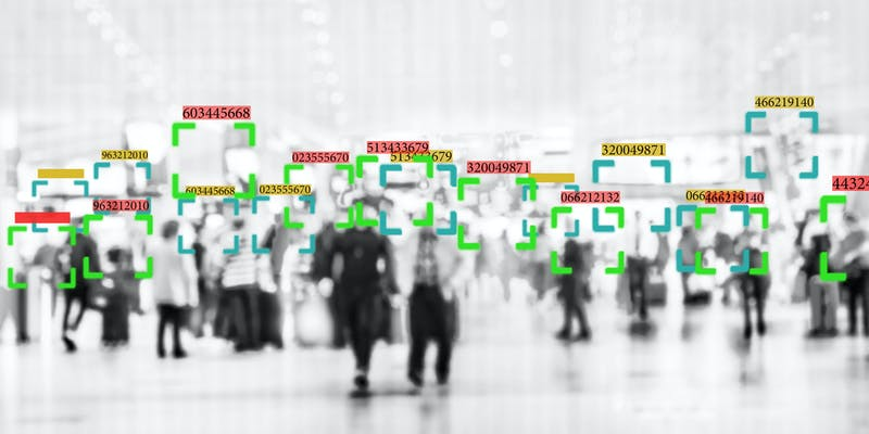 A group of people being scanned with facial recognition technology.
