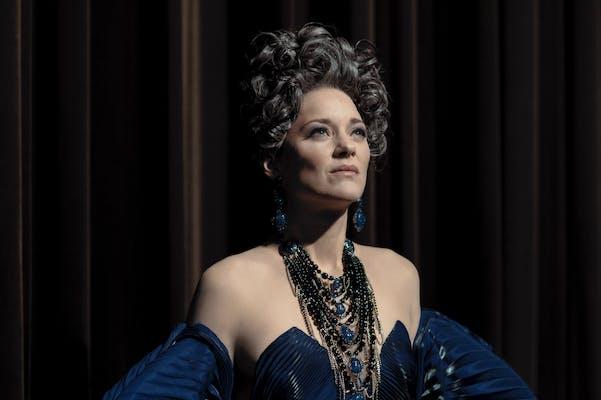 opera singer in blue dress listening for applause