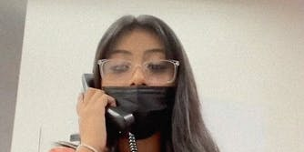 A woman on a telephone.