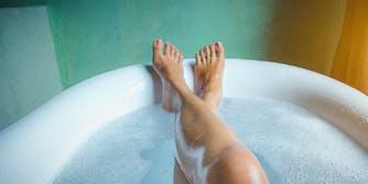 Legs in a bathtub.