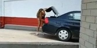 woman yelling into trunk of car while closing it