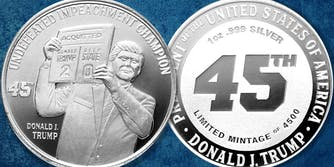 """Silver coins struck with Trump holding up a sign reading """"Acquitted - Donald Trump 2 / Deep state 0"""" with Undefeated Impeachment Champion Donald J Trump"""