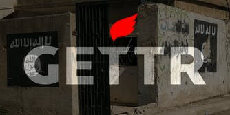 GETTR logo over building with ISIS flag graffiti