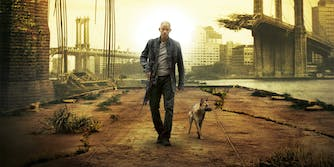 will smith walking with rifle and dog in bombed out city