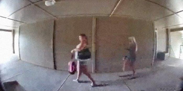 Two women walking down a hallway.