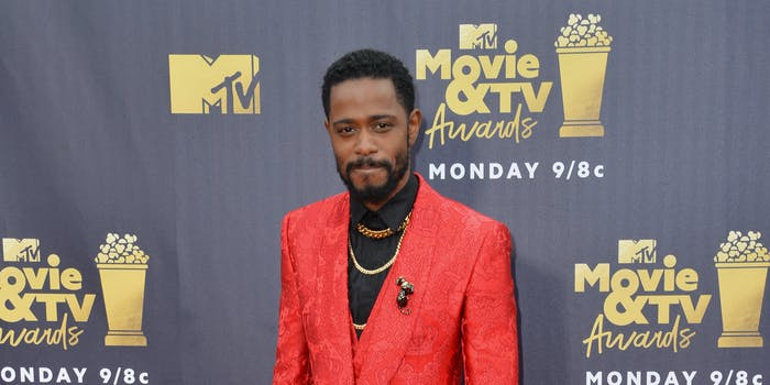 man in red suit on the red carpet