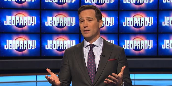 Mike Richards in front of Jeopardy! screen background