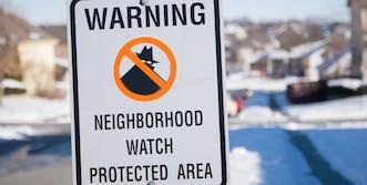 neighborhood watch sign in the snow