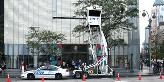 A NYPD car and surveillance tower.