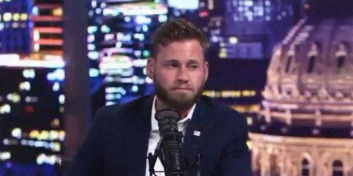 A man at a microphone.