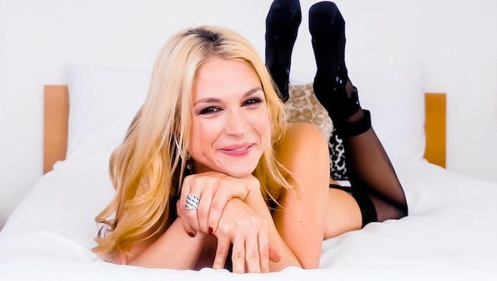 POVBlowjobs star Sarah Vandella lying on a bed