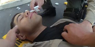 A police officer being given medication.
