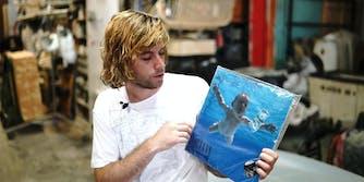 A man holding a vinyl record.