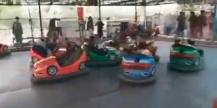 Members of the Taliban riding bumper cars
