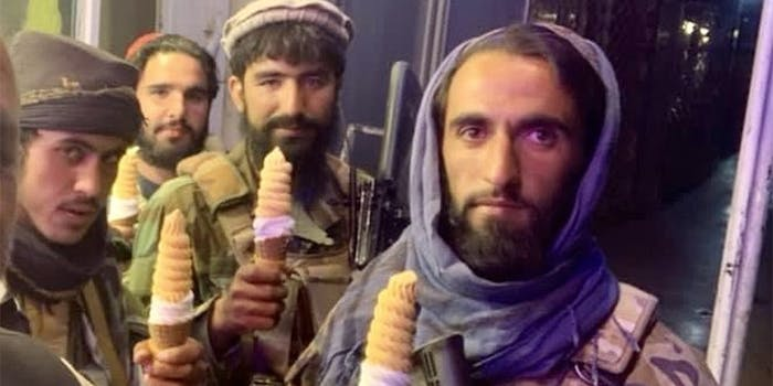 Taliban soldiers posing with ice cream cones