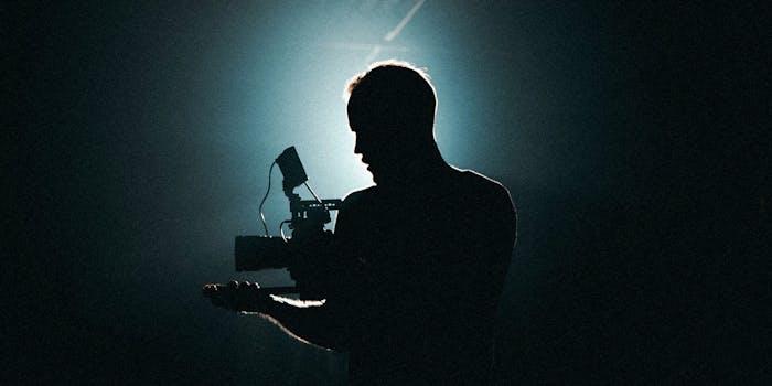 A man using a video camera.