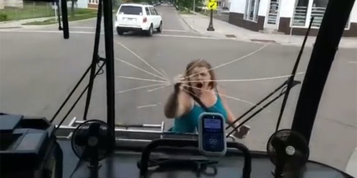 woman smashes bus window