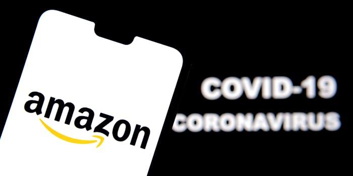 Amazon logo on a smartphone and Coronavirus COVID-19 words on blurred background.