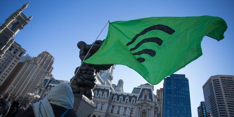 Protestors advocating for net neutrality rally on the streets of Philadelphia, Saturday, January 13, 2018.