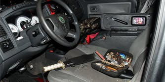 A photo from the U.S. Capitol Police showing the interior of a car belonging to a man who was arrested. The car has hate symbols drawn on it and knives inside.