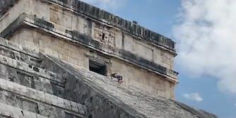 A person climbing a temple.