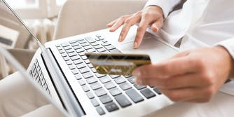 A person paying for their broadband internet service with a credit card.