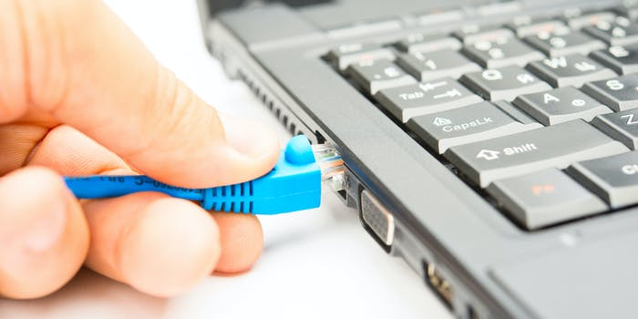A person connecting to broadband internet through an ethernet cable.