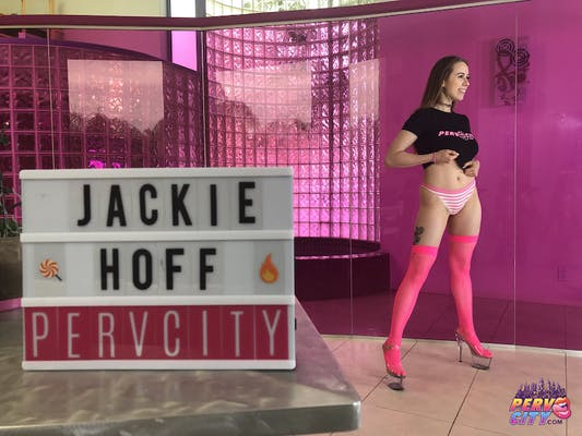 Jackie Hoff stands in long pink socks and heels in an advertisement for Perv City