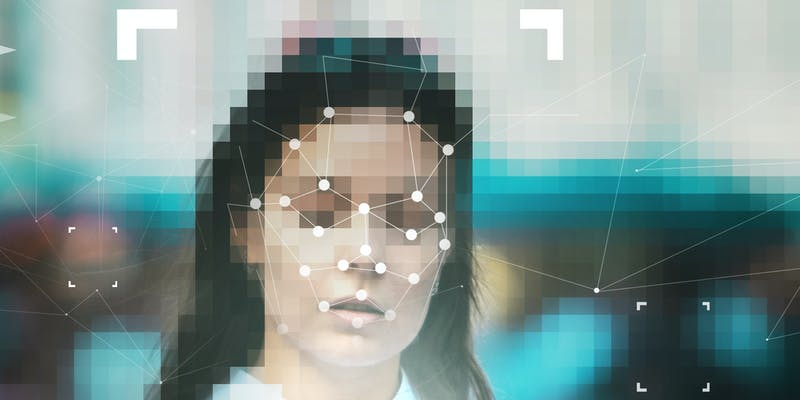 A woman's face being scanned with facial recognition technology.