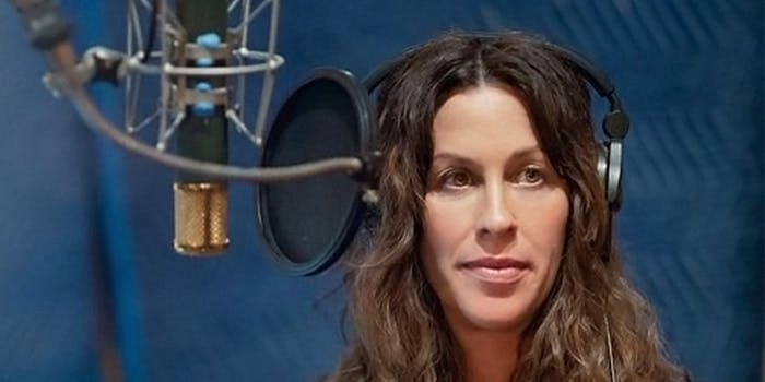 Alanis Morissette with headphones and a condenser mic